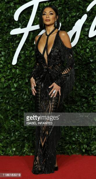 US singer Nicole Scherzinger poses on the red carpet upon arrival at The Fashion Awards 2019 in London on December 2 2019 The Fashion Awards are an...