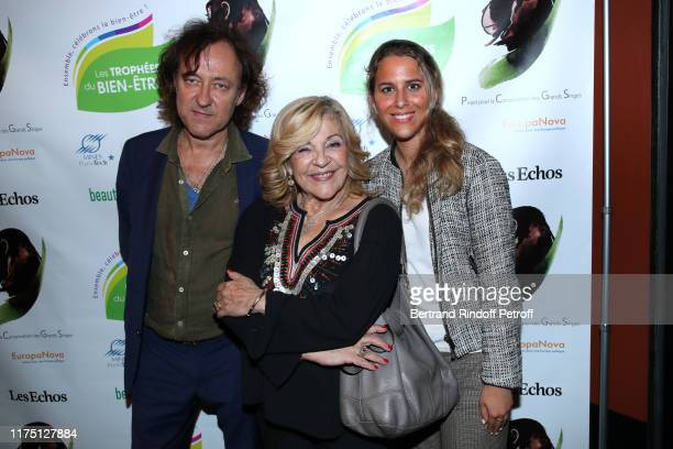 Singer Nicoletta standing between her husband JeanChristophe Molinier and Sarah Saldmann attend the 5th Trophees du Bien Etre Award Ceremony at...
