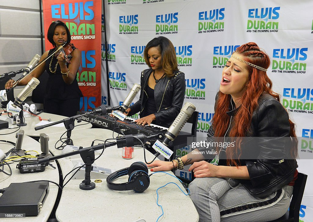 Singer Nikki Williams (R) with musicians Bianca McClure (L) and Brittani Washington (C) perform at Elvis Duran Z100 Morning Show at Z100 Studio on May 16, 2013 in New York City.