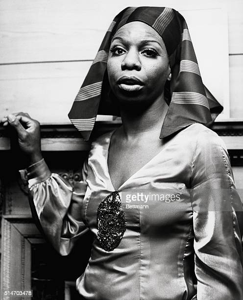 Singer Nina Simone wears a 'pharaohstyle' scarf and silk blouse