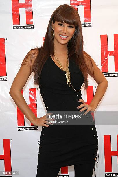 Singer Ninel Conde poses for photographers before she signs copies of her cover of H Para Hombres magazine at Plaza Cuicuilco on November 16 2010 in...