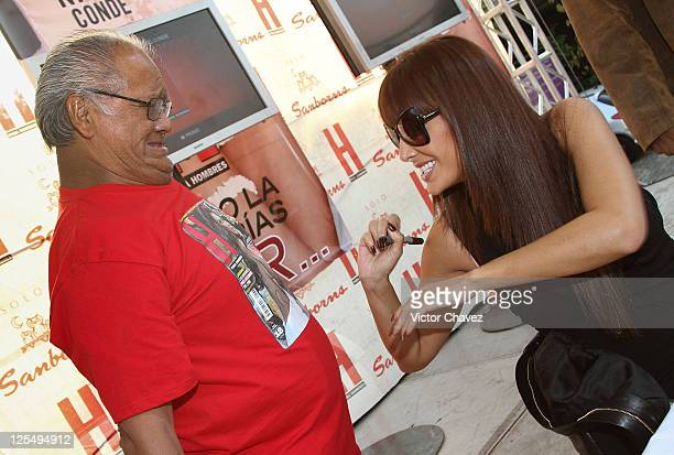 Singer Ninel Conde signs a tshirt for a fan during the H Para Hombres Magazine event at Plaza Cuicuilco on November 16 2010 in Mexico City Mexico