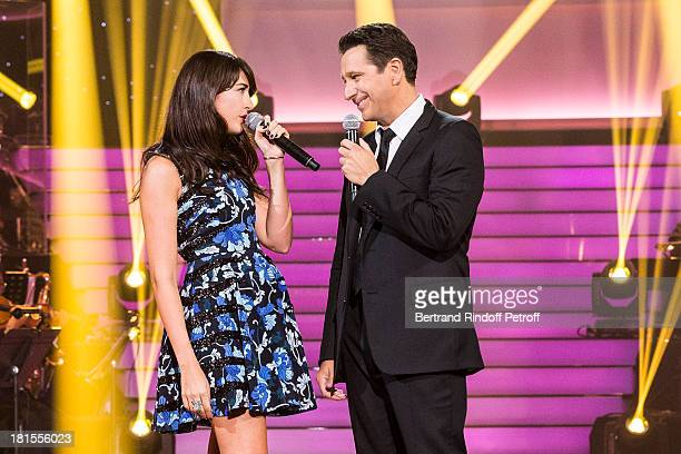 Singer Nolwenn Leroy and impersonator Laurent Gerra impersonating singer Renaud perform the song Mistral Gagnant during the live broadcast on public...