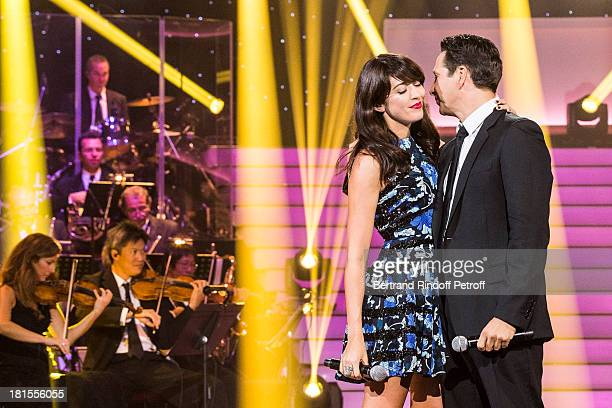 Singer Nolwenn Leroy and impersonator Laurent Gerra impersonating singer Renaud kiss after performing the song Mistral Gagnant during the live...