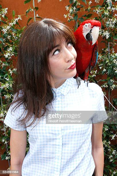Singer Nolwenn Leroy and parrot Arthur attend the 2016 French Tennis Open Day Six at Roland Garros on May 27 2016 in Paris France