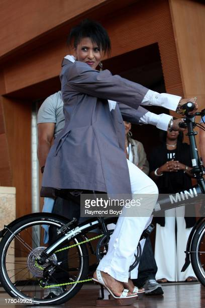 Singer Nona Hendryx brings out the new MINI bike during Chaka Khan's '40th Anniversary 60th Birthday' concert at the Jay Pritzker Pavilion in Chicago...