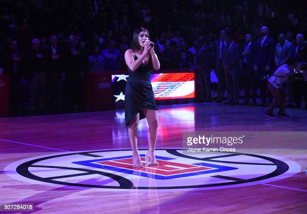 Singer Nouri sings the National Anthem before the game between the Los Angeles Clippers and the New York Knicks at Staples Center on March 2 2018 in...