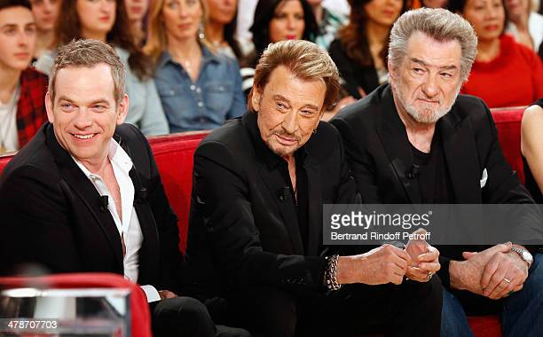 Singer of 'Au milieu de ma vie' new album Garou actors of the movie 'Salaud on t'aime' Johnny Hallyday and Eddy Mitchell attend the 'Vivement...