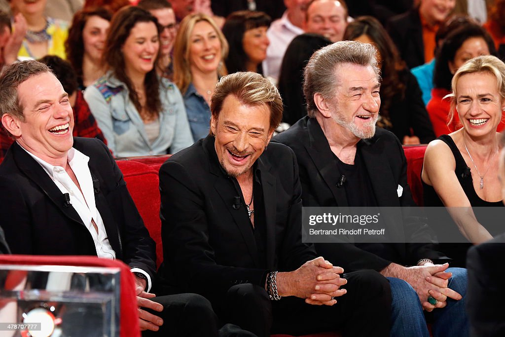 Singer of 'Au milieu de ma vie' new album, Garou and actors of the movie 'Salaud, on t'aime' Johnny Hallyday, Eddy Mitchell and Sandrine Bonnaire attend the 'Vivement Dimanche' French TV show at Pavillon Gabriel on March 14, 2014 in Paris, France.