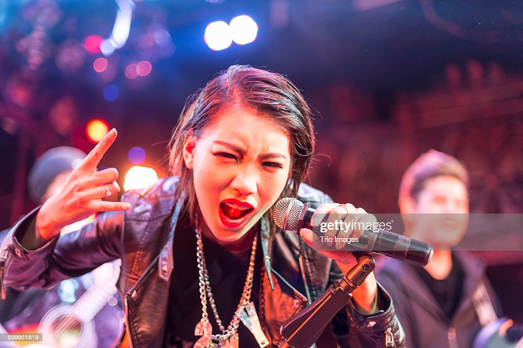 singer of the band performing on stage : Stock Photo