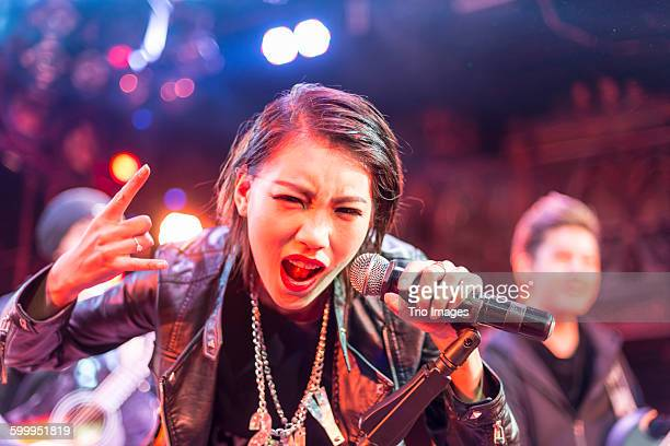 singer of the band performing on stage - singer stock pictures, royalty-free photos & images