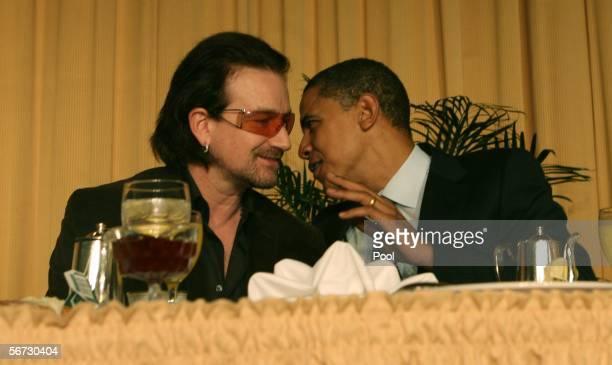 Singer of the group U2 Bono and Senator Barack Obama talk at the National Prayer Breakfast in WashingtonDC on February 2 2006