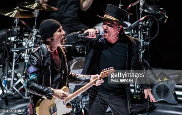 Singer of the Irish band U2 Bono performs during one of it's two concerts at the Ziggo Dome in Amsterdam The Netherlands October 7 as part of the...