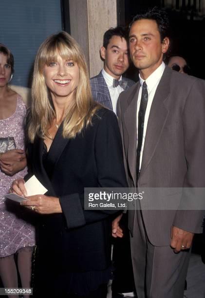 Singer Olivia Newton John and husband Matt Lattanzi attend the City of Angels Opening Night Performance on June 12 1991 at the Shubert Theatre in...