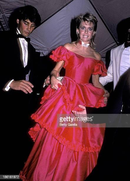 Singer Olivia NewtonJohn and boyfriend Matt Lattanzi attend the 23rd Annual Grammy Awards on February 23 1983 at Shrine Auditorium in Los Angeles...