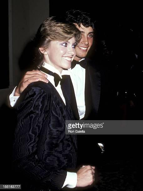 Singer Olivia Newton-John and boyfriend Matt Lattanzi attends the Ninth Annual American Film Institute Lifetime Achievement Award Salute to Fred...