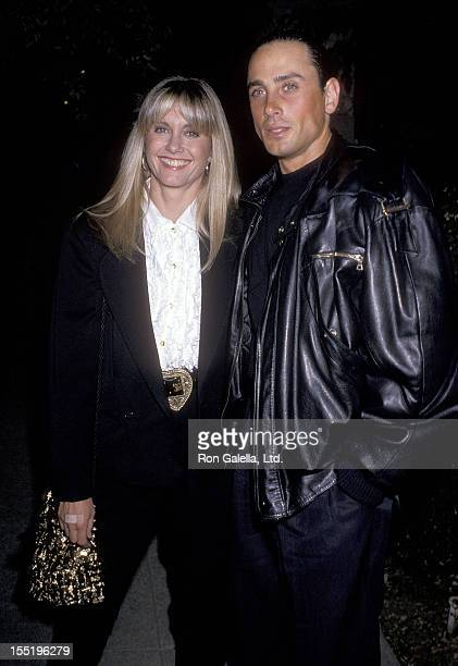 Singer Olivia NewtonJohn and husband Matt Lattanzi attend John Reid's 40th Birthday Party on September 9 1989 in Beverly Hills California