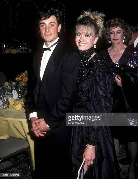 Singer Olivia Newton-John and husband Matt Lattanzi attend the 13th Annual American Film Institute Lifetime Achievement Award Salute to Gene Kelly on...