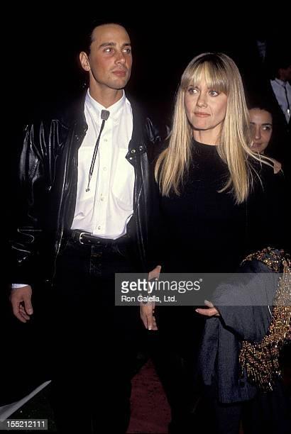 Singer Olivia NewtonJohn and husband Matt Lattanzi attend the 17th Annual American Music Awards on January 22 1990 at Shrine Auditorium in Los...