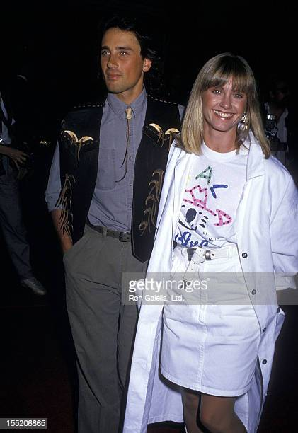 Singer Olivia NewtonJohn and husband Matt Lattanzi attend the Crocodile Dundee II Hollywood Premiere on May 22 1988 at Mann's Chinese Theatre in...