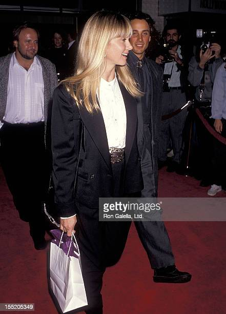 Singer Olivia NewtonJohn and husband Matt Lattanzi attend the Immediate Family Hollywood Premiere on october 24 1989 at Mann's Chinese Theatre in...