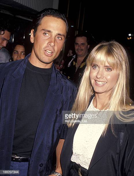 Singer Olivia NewtonJohn and husband Matt Lattanzi attend the Out There Tonight Opening Night Performance on August 29 1990 at the Pantages Theatre...
