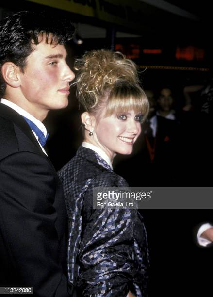 Singer Olivia NewtonJohn and husband Matt Lattanzi attend the 'Rocky IV' Westwood Premiere on November 21 1985 at Mann Village Theatre in Westwood...