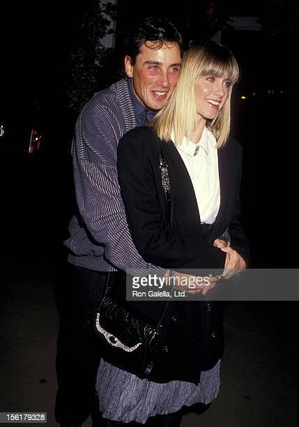 Singer Olivia NewtonJohn and husband Matt Lattanzi attend the 'Siesta' Culver City Premiere on October 29 1987 at the Cary Grant Theatre in Culver...