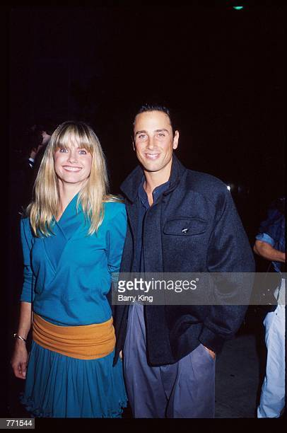 """Singer Olivia Newton-John and husband Matt Lattanzi smile at the ECO benefit premiere of the film """"Look Who's Talking"""" October 12, 1989 in Los..."""