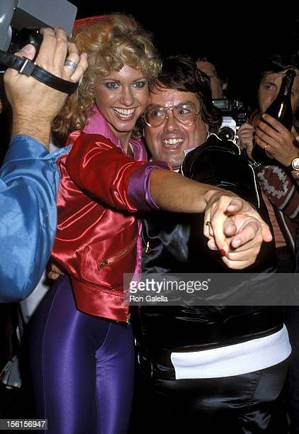 Singer Olivia Newton-John and producer Allan Carr attend the 'Grease' Premiere Party on June 13, 1978 at Studio 54 in New York City.