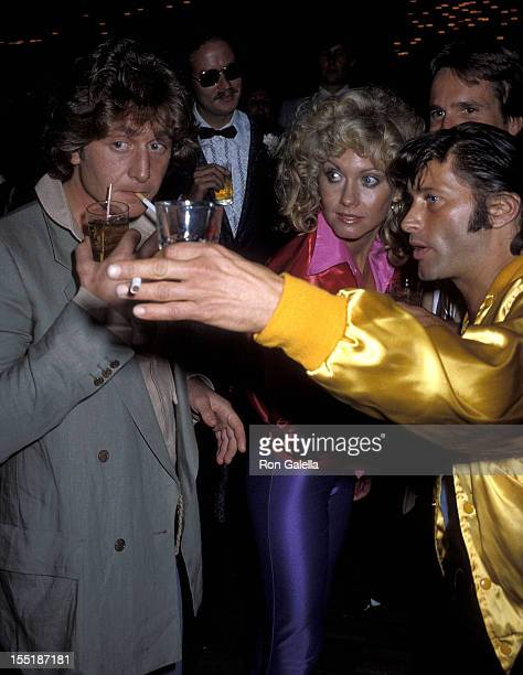 Singer Olivia NewtonJohn date Lee Kramer and guest attend the 'Grease' Premiere Party on June 13 1978 at Studio 54 in New York City