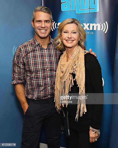 Singer Olivia NewtonJohn poses for a photo with host Andy Cohen during a visit to SiriusXM's 'Radio Andy' at the SiriusXM Studio on October 3 2016 in...