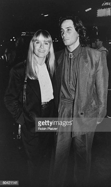 Singer Olivia Newton-John w. Husband, actor Matt Lattanzi attending benefit screening of the motion picture Immediate Family, for the Pediatric AIDS...