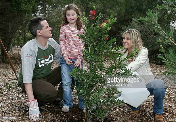 Singer Olivia NewtonJohn with cofounder managing director of Planet Ark Jon Dee and child Isabelle Brooks attend the National Tree Day 10th...
