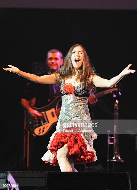 Singer Olivia Ruiz performs on stage during the Peace One Day 10th Anniversary concert at Le Grand Rex on September 19, 2009 in Paris, France.