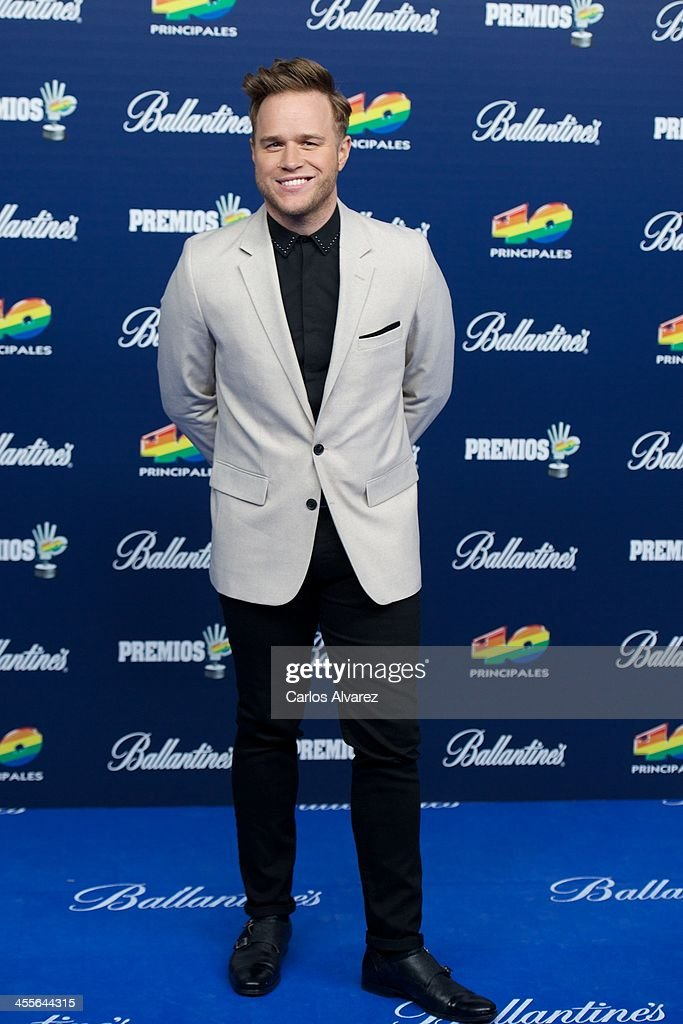 Singer Olly Murs attends the '40 Principales Awards' 2013 photocall at Palacio de los Deportes on December 12, 2013 in Madrid, Spain.