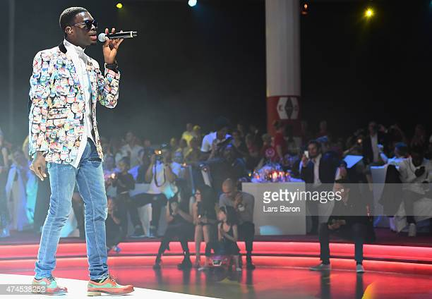 Singer Omi performes during the FC Bayern Muenchen Champions dinner at Postpalast on May 23 2015 in Munich Germany