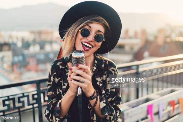 singer on the rooftop - pop musician stock photos and pictures