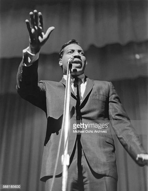 Singer Otis Redding in an Atlantic Records publicity still performs at the Apollo Theater in Harlem on November 16 1963 in New York City New York