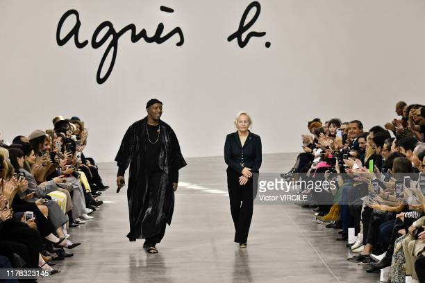 Singer Oxmo Puccino and designer Agnes Trouble walk the runway during the Agnes B Ready to Wear Spring/Summer 2020 fashion show as part of Paris...