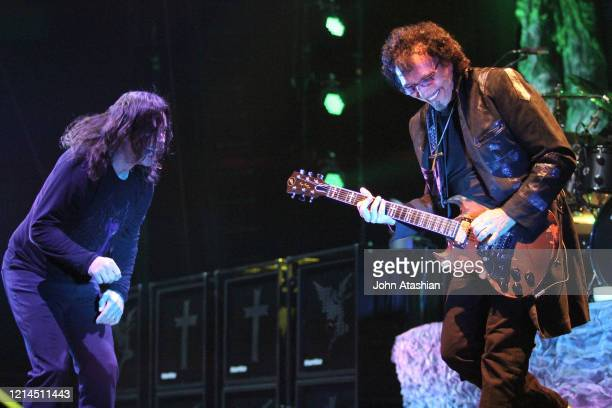 Singer Ozzy Osbourne and guitarist Tony Iommi are shown performing on stage during a live concert appearance on August 8 2013 n