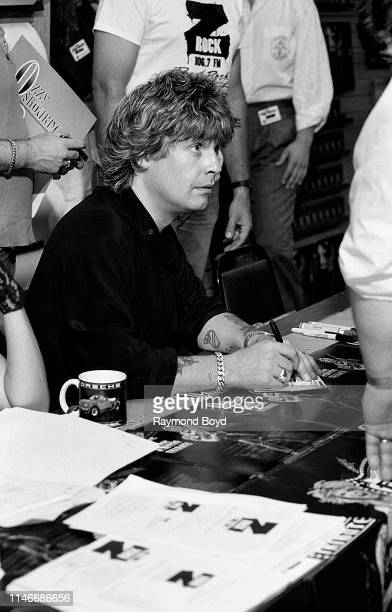 Singer Ozzy Osbourne signs autographs and greets fans at Flipside Records in Hoffman Estates Illinois in May 1987