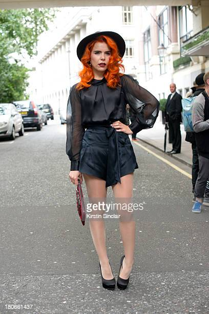 Singer Paloma Faith wears Temperley top and shorts, Charlotte Olympia shoes, Keeley Hunter hat and a Mawi bag on day 3 of London Fashion Week...