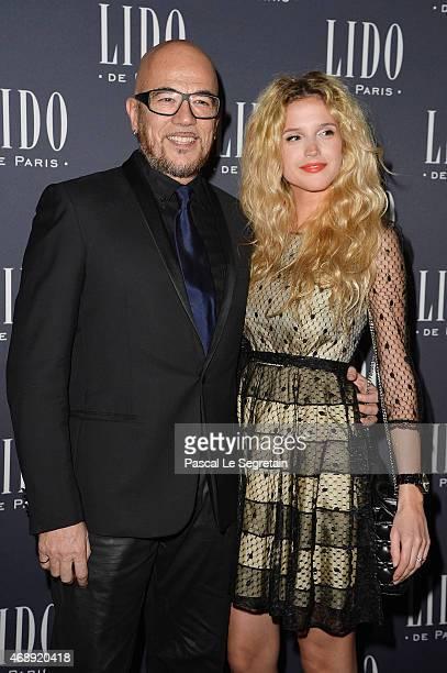 Singer Pascal Obispo and his companion Julie Hantson attend the 'Paris Merveilles' Lido New Revue Opening Gala at Le Lido on April 8 2015 in Paris...