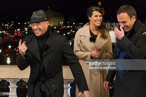 Singer Pascal Obispo television show hosts Karine Ferri and Nikos Aliagas attend the shooting of the year end program 'Toute la musique qu'on aime '...