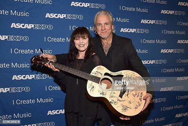 Singer Pat Benatar and musician Neil Giraldo pose with a #StandWithSongwriters guitar which will be presented in May to members of Congress to urge...