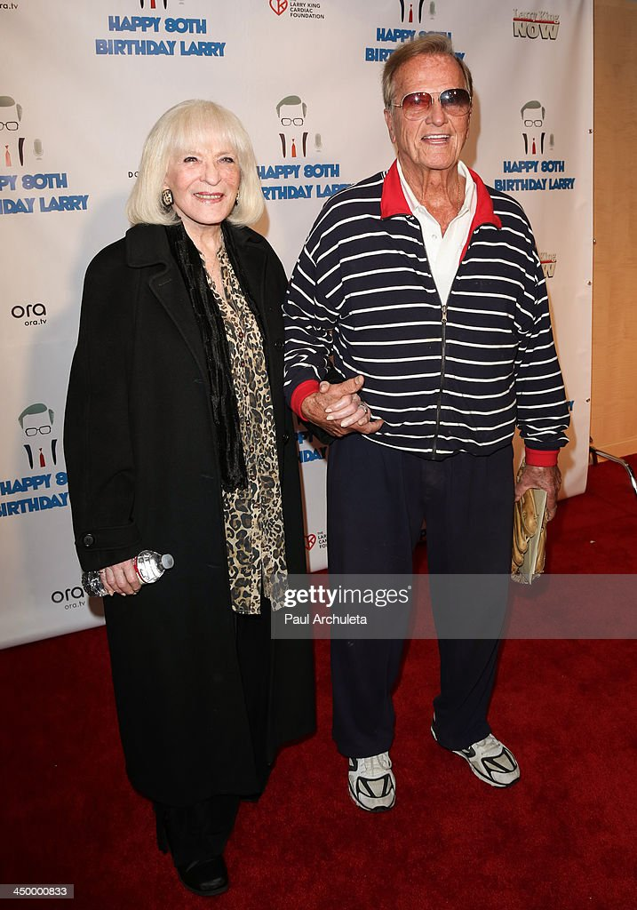 Singer Pat Boone (R) and his wife Shirley Boone attend a surprise party for Larry King's 80th Birthday at Dodger Stadium on November 15, 2013 in Los Angeles, California.