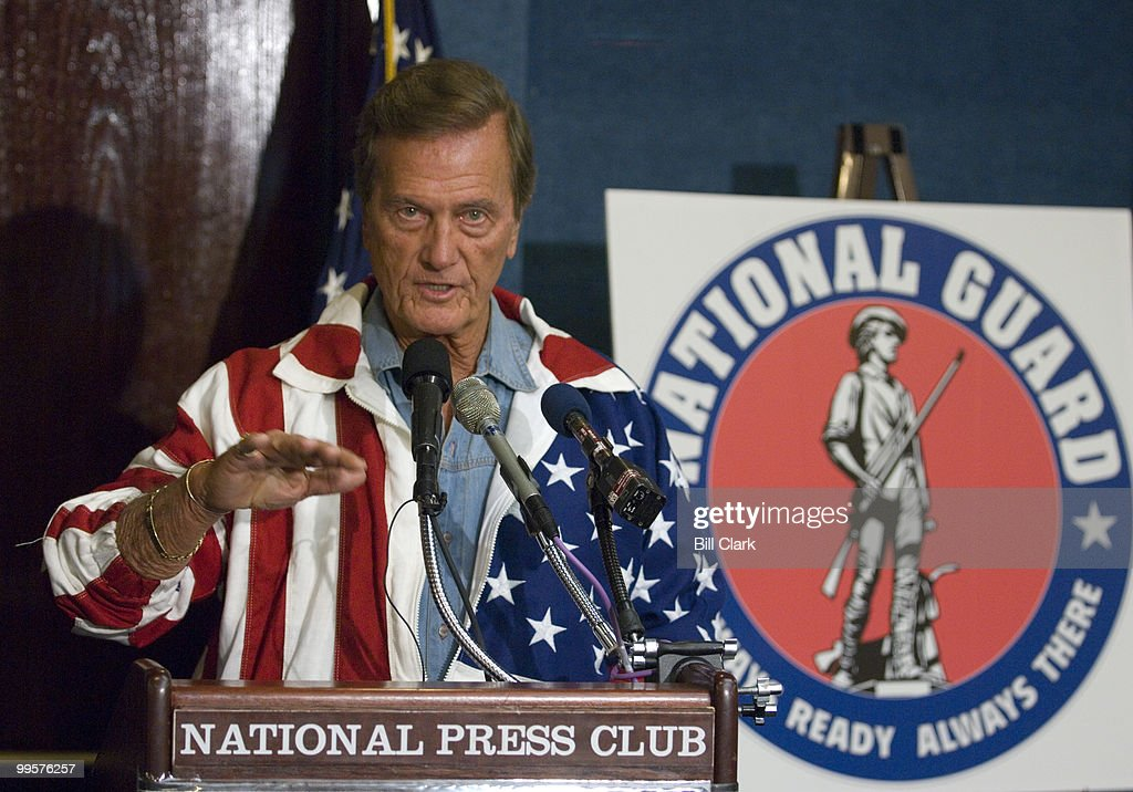 Singer Pat Boone holds a news conference to unveil the National Guard documentary 'For My Country' at the National Press Club on Friday, May 25, 2007. Boone began his remarks by claiming he wasn't wearing an American Flag, and that he would never disresepct the flag.