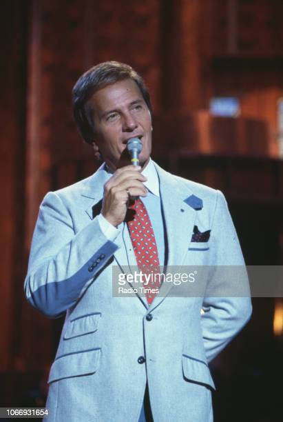 Singer Pat Boone performing on a television show, December 11th 1985.