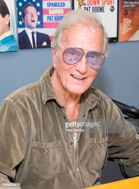 Singer Pat Boone signs a 70th Anniversary Commemorative print honoring the Exodus ship's contribution to Jewish and world history at Pat Boone...